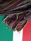Mexican rebozo multicolor with stripes, with green, white and red background. Backdrop for mexican celebrations and traditions of the month of september stock photos