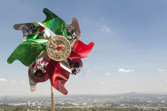 Mexican Rehilete. Memorial to September 15. Background can appreciate valley of Mexico and the blue sky with clouds stock image