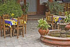 Mexican Restaurant with Fountain. Courtyard mexican restaurant with a fountain and colorful tables Royalty Free Stock Images