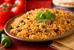 Mexican Rice. A plate of delicious authentic Mexican Rice with black beans, corn, garlic, and cilantro Stock Images