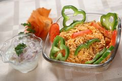 Mexican Rice, Simple Mexican Rice. Mexican rice is a staple food in Mexican and Latin American cuisine. Rice is not a new world food, rice was introduced to Royalty Free Stock Images