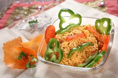 Mexican Rice, Simple Mexican Rice. Mexican rice is a staple food in Mexican and Latin American cuisine. Rice is not a new world food, rice was introduced to Stock Image