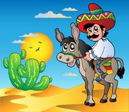 Mexican riding donkey in desert Royalty Free Stock Photos