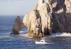 Mexican Riviera`s Rocks. The boat passing by famous rock arch of Cabo San Lucas resort town Mexico stock images