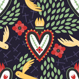 Mexican Sacred Heart Pattern. A colorful seamless Mexican sacred heart pattern with crosses, birds, and flowers Royalty Free Stock Image