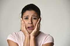 Mexican sad woman serious and concerned crying desperate overacting on feeling depressed. Young beautiful Mexican sad woman serious and concerned crying Royalty Free Stock Photo