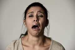 Mexican sad woman serious and concerned crying desperate overacting on feeling depressed. Young beautiful Mexican sad woman serious and concerned crying Royalty Free Stock Image