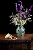 Mexican sage with silver lace flowers in a mosaic vase next to a royalty free stock image
