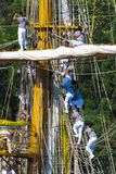 Mexican sailors climb the ropes on the masts of a sailboat. The training ship `Cuauhtemoc` was in the port of Odessa, Ukraine. ARM Cuauhtémoc BE-01 - training royalty free stock photo