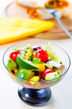 Mexican salad. In mexican colors with burritos in a background. Salad is made of fresh vegetables and its very delicious and healthy Stock Photo