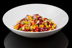MEXICAN SALAD with reflection  on black background royalty free stock photography