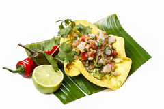 Mexican salad in a tortilla on banana leaf Royalty Free Stock Image