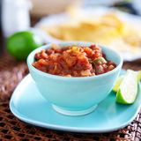 Mexican salsa in blue bowl Stock Photos