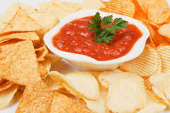 Mexican salsa with corn and potato chips. Homemade mexican salsa with corn and potato chips Stock Images