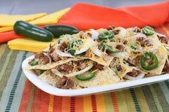 Mexican Sausage, Bean and Cheese Nachos Stock Photos
