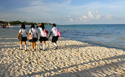 Mexican schoolgirls´ beach walk. Mexican teenage girls on their way back from school. Playa del Carmen, August 2010 Royalty Free Stock Photo