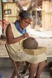 Mexican senior woman cutting designs into barro negro pottery, O. A mexican senior woman is cutting designs into unfired barro negro pottery in San Bartolo royalty free stock photos