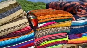 Mexican serape blanket in a row at Mexico. Outdoor shop Stock Photos
