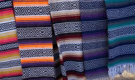 Mexican serape blanket in a row at Mexico. Outdoor shop Stock Photography