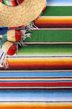 Mexican background sombrero blanket copy space vertical Royalty Free Stock Images