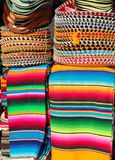 Mexican serape colorful stacked and charro hats Royalty Free Stock Image