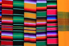 Mexican serape fabric colorful pattern texture. Background Royalty Free Stock Images