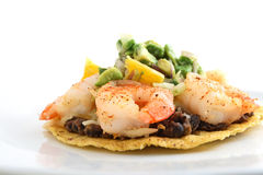 Mexican shrimp tostada with refried beans Stock Photo