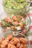 Mexican sides. Delicious mexican sides guacamole pico de gallo and pinto beans stock photography