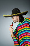 The mexican smoking pipe wearing sombrero Royalty Free Stock Photo