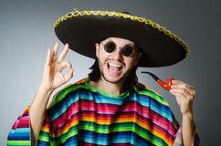 The mexican smoking pipe wearing sombrero Stock Photo