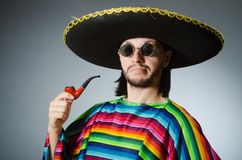 The mexican smoking pipe wearing sombrero Stock Images