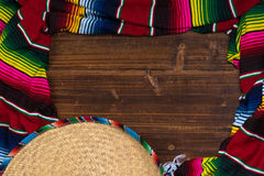 Mexican Sobrero and Serape blanket on wooden background with cop Royalty Free Stock Photo