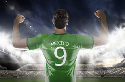 Mexican soccer player in the stadium Royalty Free Stock Photo
