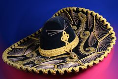 Mexican sombrero. Black mexican hat over colored background Stock Photos