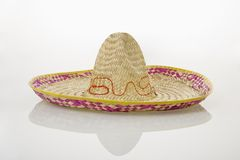 Mexican sombrero hat. Mexican straw sombrero hat on white background Royalty Free Stock Photo