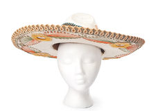 Mexican Sombrero Hat Isolated on White. Mexican sombrero hat resting on a head for proper perspective. Isolated with a clipping path Royalty Free Stock Image