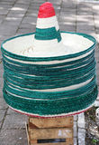 Mexican sombrero hats. Pile of Mexican sombrero hats in colors of national flag outdoors royalty free stock photo
