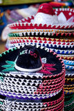 Mexican sombrero is for sale. Stack of colorful Mexican sombreros for sale in Cabo San Lucas Stock Image
