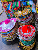 Sombreros. Mexican sombreros and blankets at a souvenir shop in Cabo San Lucas, Mexico royalty free stock images