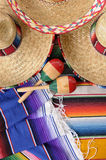 Mexican sombreros and maracas. Mexican scene with sombrero straw hat, maracas and traditional serape blanket or rug.  Space for copy Royalty Free Stock Photos