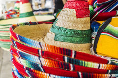 Mexican Sombreros. Stacked Mexican sombreros at a street market royalty free stock photography