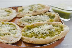 Mexican sopes with grated cheese and green salsa, mexican food spicy in mexico. Memelas stock photography