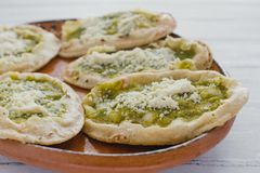 Mexican sopes with grated cheese and green salsa, mexican food spicy in mexico. Memelas stock images
