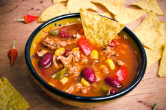 Mexican soup with tacos Stock Images