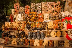Mexican Souvenirs made of wood in the market for tourists. Masks tribe Maya, skulls, figurines and arts and crafts. Mexico.  royalty free stock photo