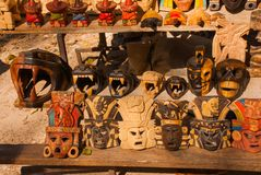 Mexican Souvenirs made of wood in the market for tourists. Masks tribe Maya, skulls, figurines and arts and crafts. Mexico.  royalty free stock image