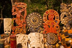 Mexican Souvenirs made of wood in the market for tourists. Masks tribe Maya, skulls, figurines and arts and crafts. Mexico.  stock image