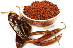 Mexican Spices. Guajillo and Arbol Chiles with Annatto Seed on White Stock Photo