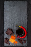 Mexican spicy hot chocolate with chili pepper and cinnamon. Top view frome above, copy space Royalty Free Stock Images