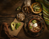 Mexican spicy soup with lime, tortilla, avocado and cream Royalty Free Stock Photo